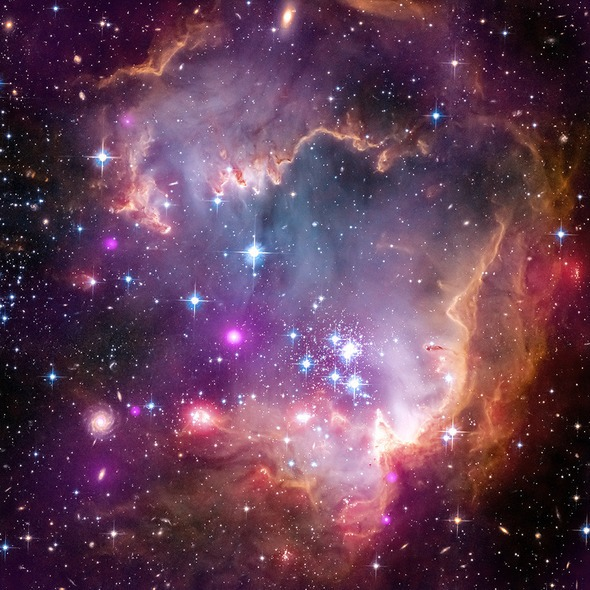 "Space in fairy land, Taken Under the ""Wing"" of the Small Magellanic Cloud"