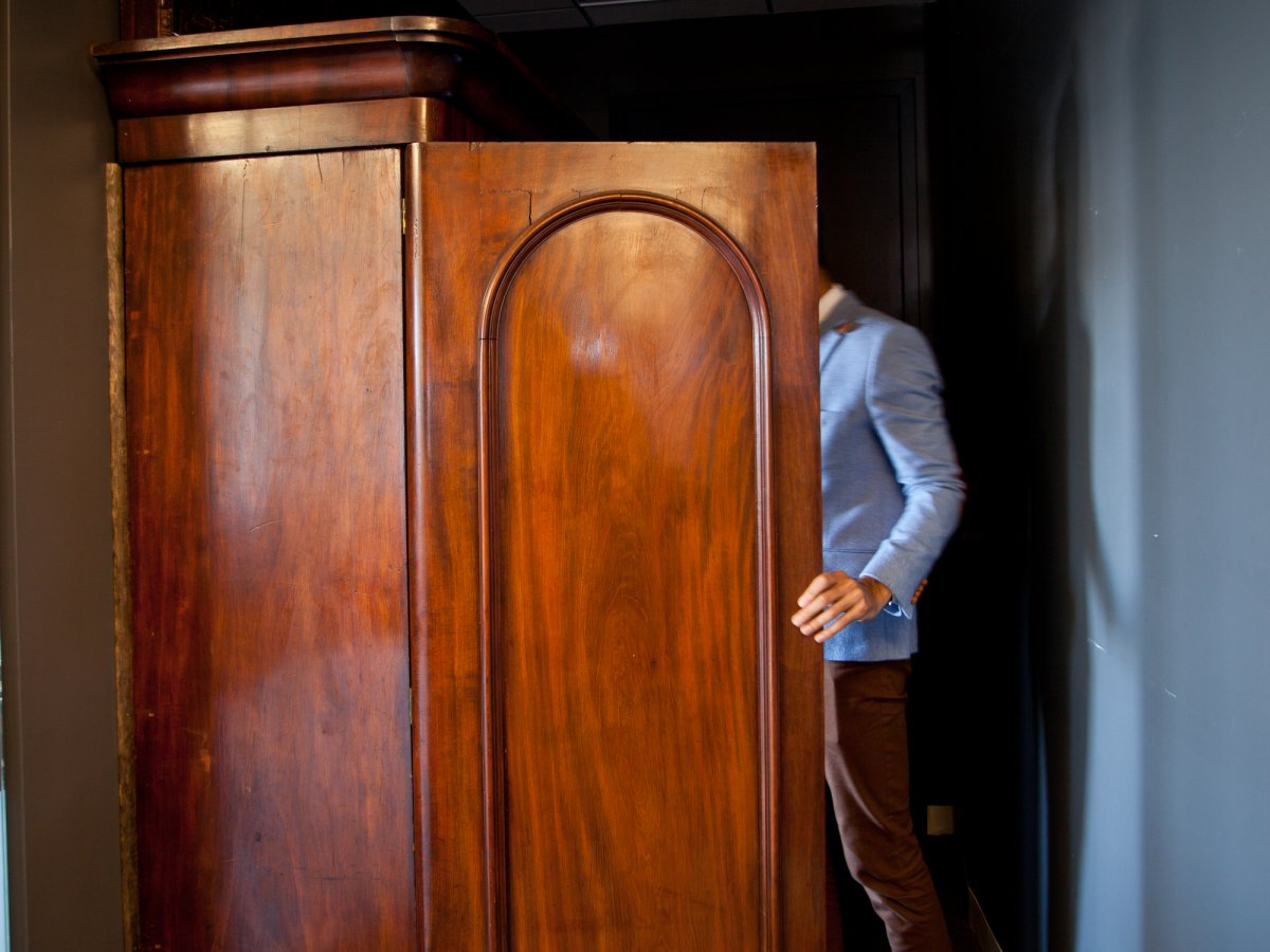 Fueled has a conference room with an entrance disguised as a wardrobe