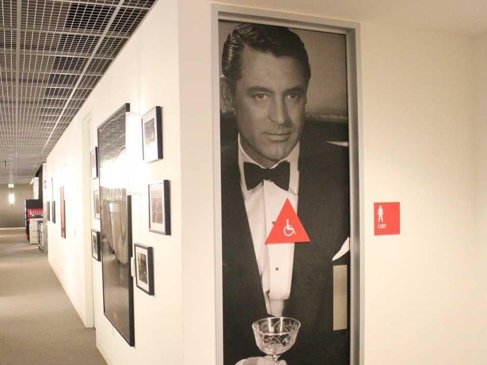 netflix has big movie photos on the bathroom doors