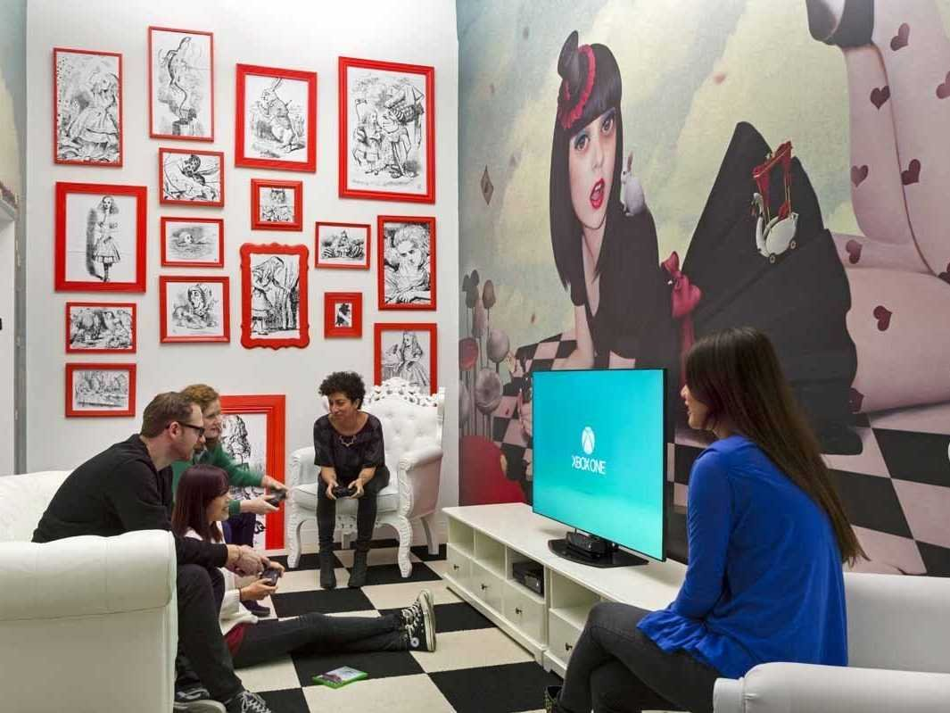Shutterstock's game room features a Lady Gaga type Alice in Wonderland.