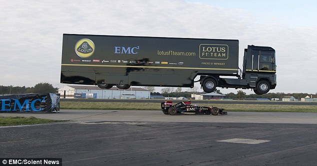 Watch a Truck Jump Over a Lotus F1 Car, Just For Fun