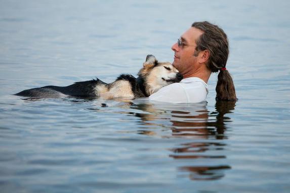 John Unger cradling his dog