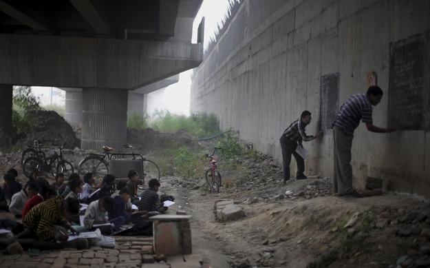 Volunteer teachers teach underprivileged kids in New Delhi, India