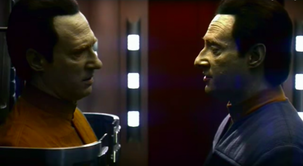 """The android Commander Data stares down an earlier version of his robot line in the film """"Star Trek: Nemesis."""" Credit: Paramount Pictures"""