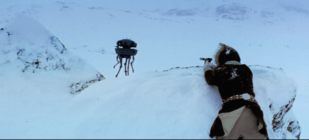 "Han Solo fires upon an Imperial probe droid on the icy planet of Hoth in ""Star Wars: The Empire Strikes Back."" Credit: Disney"