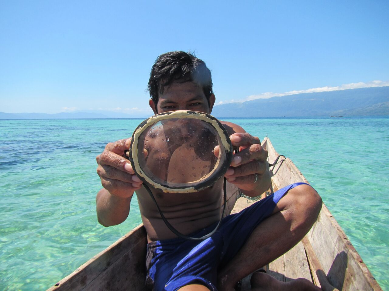 A Bajau diver shows off a traditional wooden diving mask. (Credit: Melissa Ilardo)