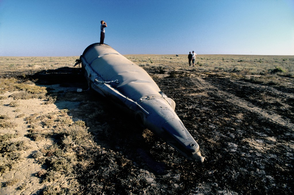Debris from a recently crashed Soyuz space rocket lies on the steppe.