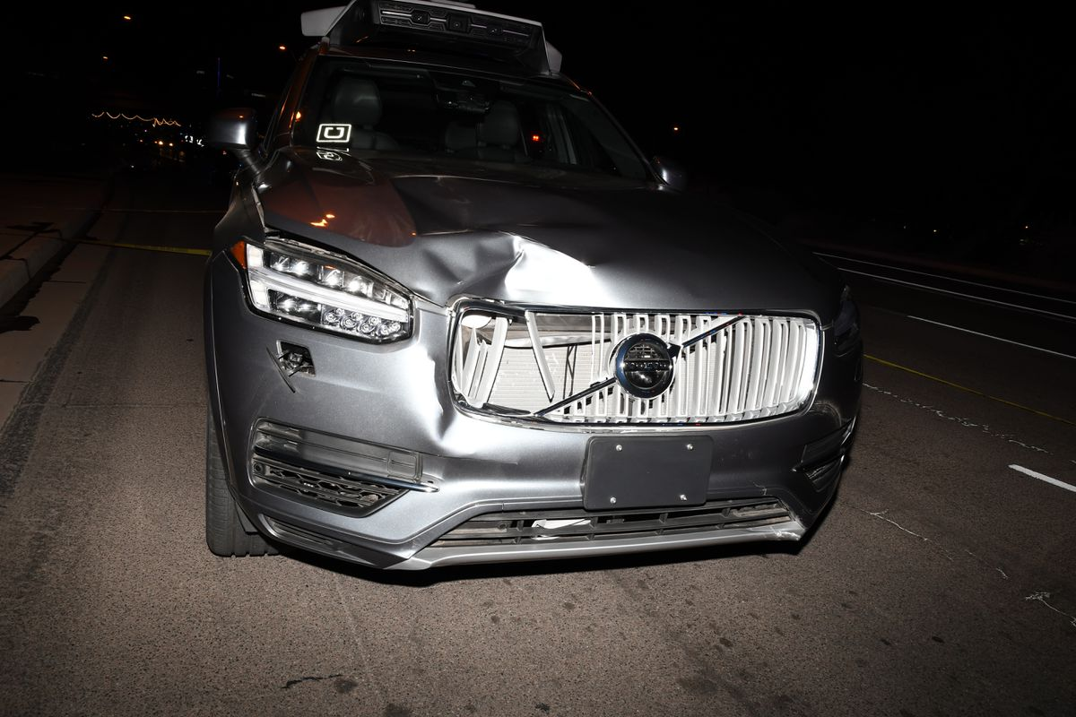 A photo from the police report show's the self-driving Uber's front-end damage after the fatal crash.