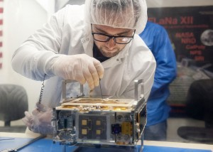 One of the Mars Cubesats being prepared by Joel Steinkraus, MarCO lead mechanical engineer at JPL. (Credit: NASA/JPL-Caltech/Tyvak/Cal Poly SLO)