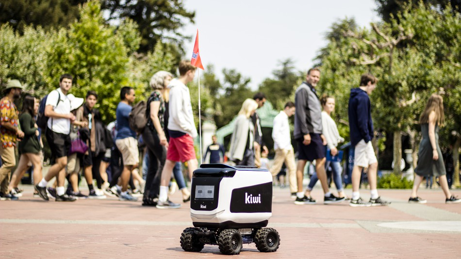 Delivery robot catches fire at university campus, students set up vigil