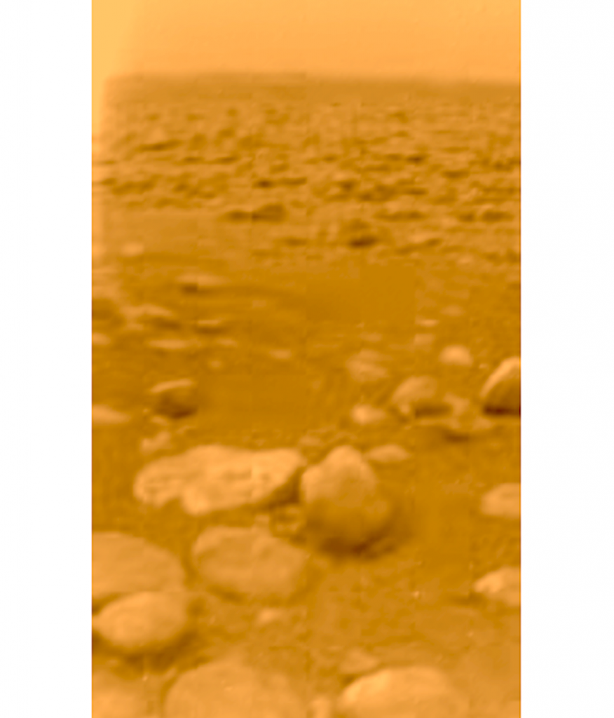First view from the surface of Titan, returned by the Huygens lander on January 14, 2005. (Credit: ESA/NASA)