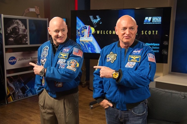 Scott and Mark Kelly (left and right, respectively) are identical twins, which made them valuable subjects for study. During Scott's time in space, his telomeres grew longer. However, upon his return, they shortened again in less than 48 hours. (Credit: NASA)